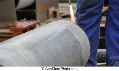 Welder Preparing a Steel Pipeline with a Blowtorch - Welder...