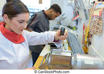 Chef holding lever of appliance