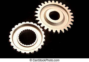 Two cogs - Two cogwheels together on dark surface