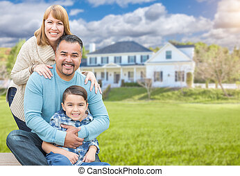 Mixed Race Family Portrait In Front of House