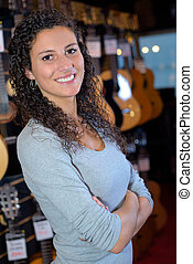 Portrait of woman in music store