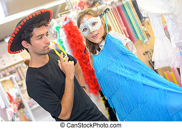friends dressing up in fancy dress shop