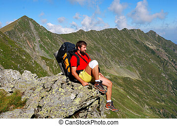 Tourist on Carpathian mountain trail - Tourist sighting the...
