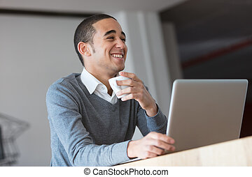 happy handsome young businessman laughing - laughter of a...