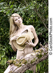 Young sexy woman with the straw hat - Young sexy woman with...