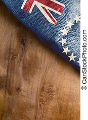Cook Islands Flag on a wooden background.