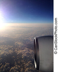 View from airplane window to airscrew during sunrise