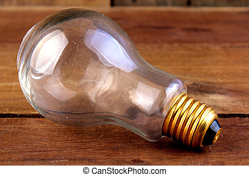 single object bulb on the wooden background