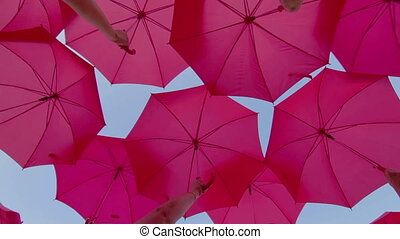 Pink umbrellas open in the sky as a decoration - Pink...