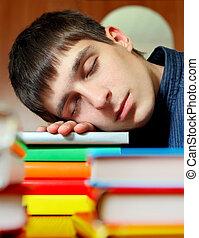 Student sleep on the Books - Tired Teenager sleep on the...