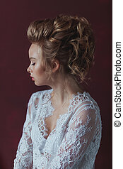 Beautiful young blond bride with fashion wedding hairstyle