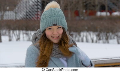Beautiful young model smiling in winter. Slow motion