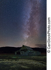 Starry over abandoned barn - Milky way in the dark night...