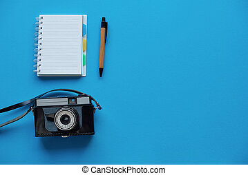 Camera and notebook directly above