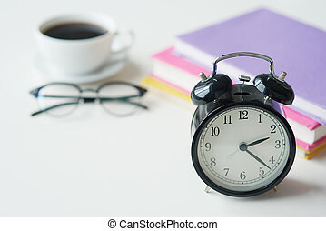 Old fashioned alarm clock in the main plan
