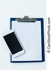 Clipboard and smartphone directly above