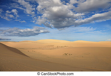 Mui Ne sand dunes. - Mui Ne sand dunes on the background of...