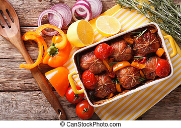 Ballotine rabbit baked with tomatoes, pepper and rosemary...