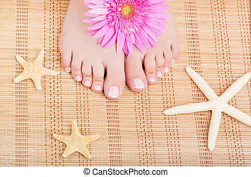 Chiropody - Close-up of beautiful manicured feet with a...