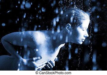 Young woman under the flying drops. - The young sexual woman...