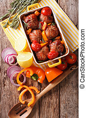 Baked fillet of rabbit with vegetables close up in baking...
