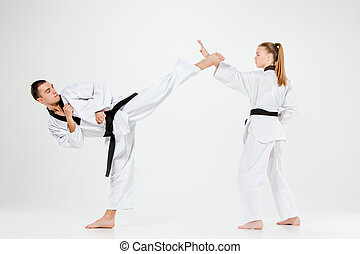 The karate girl and boy with black belts - The karate girl...