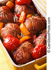 Baked rabbit fillet with vegetables in a gratin dish close...