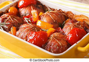 Rabbit fillet baked with tomato and pepper close up....