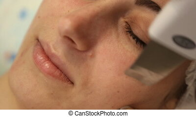 facial cleansing with an ultrasonic skrabera in beauty salon