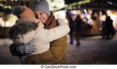 happy couple meeting and hugging on christmas - love, date,...