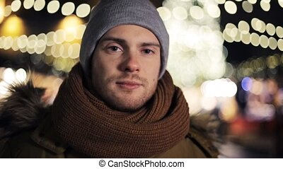 happy man in hat and winter jacket at christmas - people,...