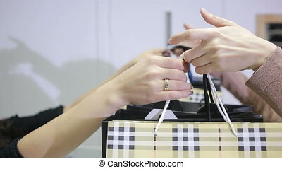 girl takes shopping at a clothing store cashier - girl takes...