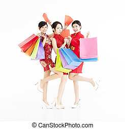 young group holding shopping bags and happy chinese new year .