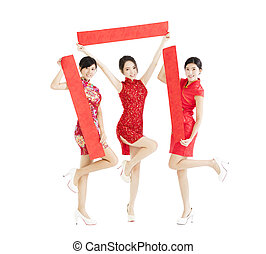happy girls showing Spring festival couplets for chinese new yea
