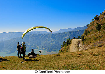 paraglider preparing to launch itself in the air. - Pokhara,...
