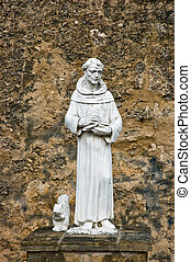 St Francis of Assisi statue outside north wall of historic...