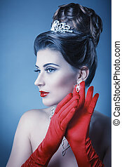 Queen - Portrait of a beautiful woman with elegant hairstyle...