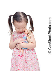 girl playing with doll over white