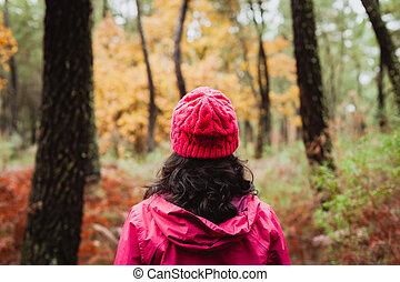 Matured woman hiking in the forest