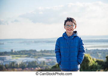 boy wearing jacket and smiling outdoor - Young asian boy...