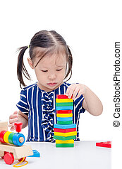 girl playing with colorful wood block