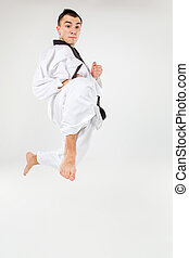 The karate man with black belt - The karate man in white...