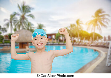 boy smiling at swiming pool - Young asian boy smiling at...