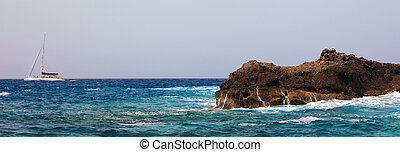Panoramic view of sailing boat and rock near Tenerife,...
