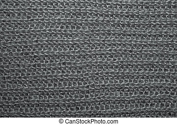 Brown fluffy woven thread sweater as a background.
