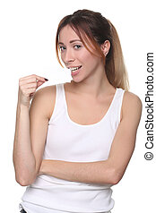 Girl biting small paper card. Close up. White background -...