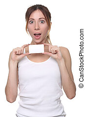 Girl with surprised face holding paper card. Close up. White...