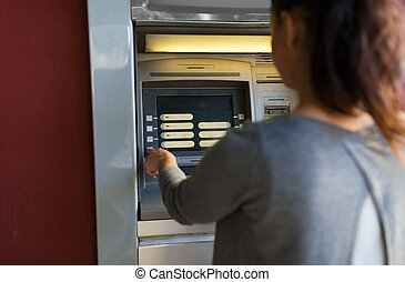 close up of woman choosing option on atm machine - finance,...
