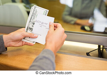 customer with money and receipt at bank counter - people,...