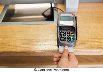 close up of hand inserting bank card to terminal - finance,...